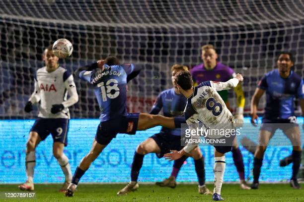 Tottenham Hotspur's English midfielder Harry Winks shoots to score their second goal during the English FA Cup fourth round football match between...