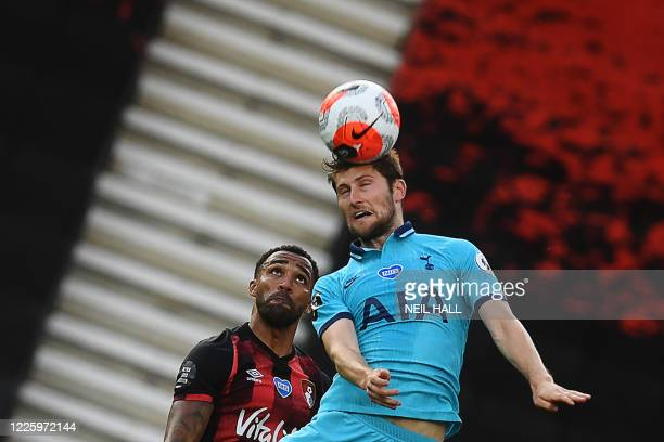 Tottenham Hotspur's English midfielder Harry Winks vies for the ball with Bournemouth's English striker Callum Wilson during the English Premier...