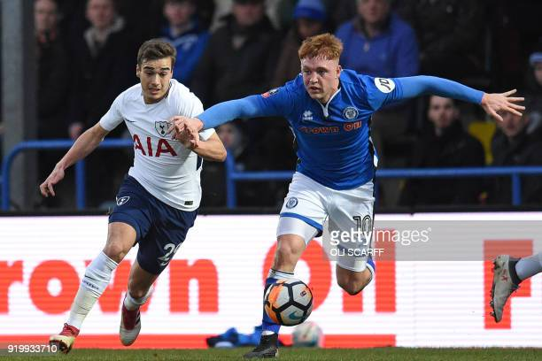 Tottenham Hotspur's English midfielder Harry Winks vies with Rochdale's Northern Irish midfielder Callum Camps during the English FA Cup fifth round...
