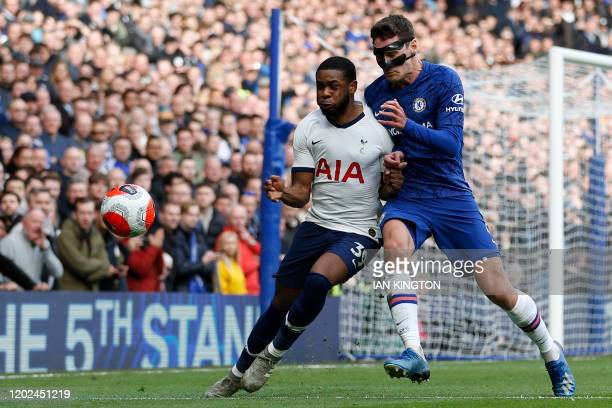 Tottenham Hotspur's English midfielder Japhet Tanganga vies with Chelsea's Danish defender Andreas Christensen during the English Premier League...