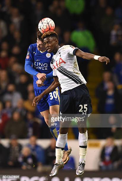 Tottenham Hotspur's English midfielder Josh Onomah vies with Leicester City's Ben Chilwell during the FA Cup thirdround football match between...