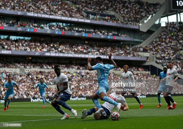 Tottenham Hotspur's English midfielder Oliver Skipp challenges Manchester City's English midfielder Raheem Sterling during the English Premier League...
