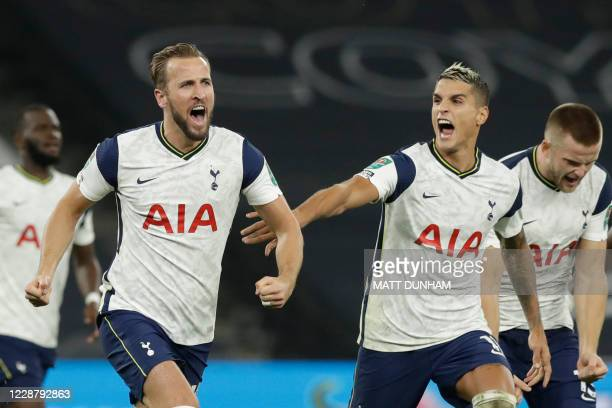 Tottenham Hotspur's English striker Harry Kane and Tottenham Hotspur's Argentinian midfielder Erik Lamela celebrate victory after Chelsea's English...