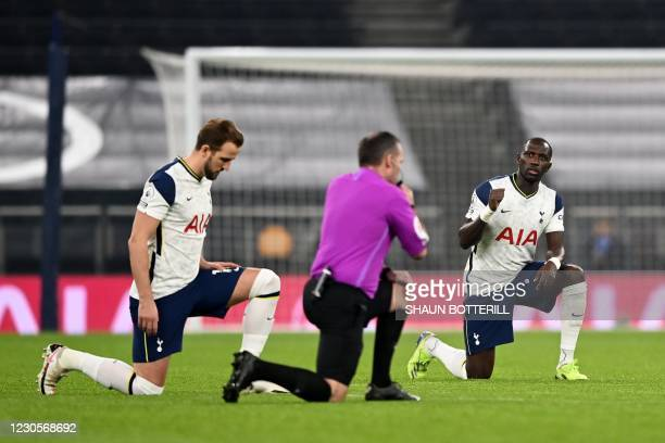Tottenham Hotspur's English striker Harry Kane and Tottenham Hotspur's French midfielder Moussa Sissoko 'take a knee' in support of the No Room For...