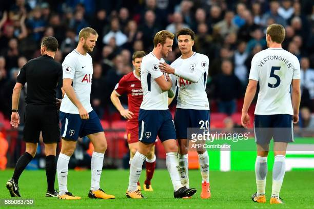Tottenham Hotspur's English striker Harry Kane and Tottenham Hotspur's English midfielder Dele Alli celebrate on the pitch after the English Premier...