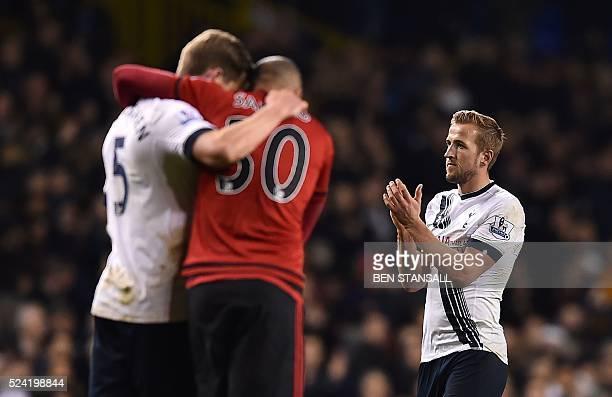 Tottenham Hotspur's English striker Harry Kane applauds as Tottenham Hotspur's Belgian defender Jan Vertonghen hugs West Bromwich Albion's Brazilian...