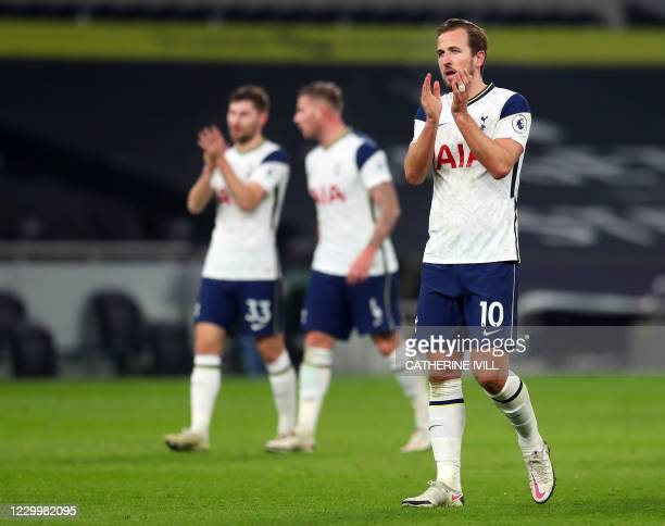 Tottenham Hotspur's English striker Harry Kane applauds the supporters after the English Premier League football match between Tottenham Hotspur and...