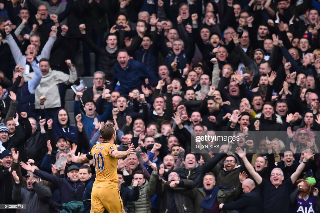 Tottenham Hotspur's English striker Harry Kane celebrates after scoring a hat-trick during the English FA Cup fifth round football match between Fulham and Tottenham Hotspur at Craven Cottage in London on February 19, 2017. / AFP / Glyn KIRK / RESTRICTED TO EDITORIAL USE. No use with unauthorized audio, video, data, fixture lists, club/league logos or 'live' services. Online in-match use limited to 75 images, no video emulation. No use in betting, games or single club/league/player publications. /