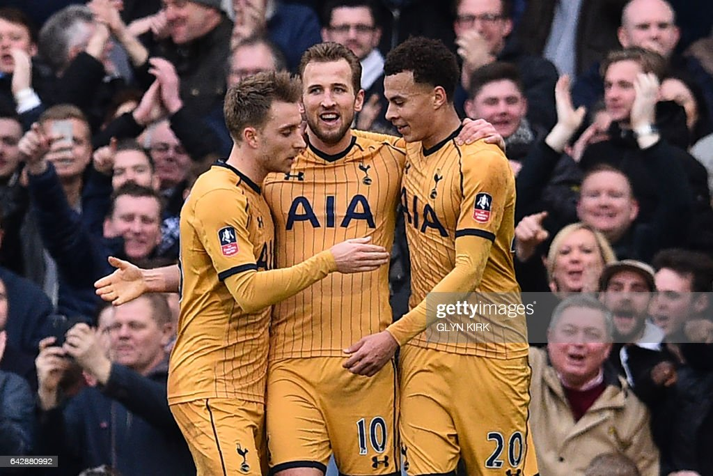 Tottenham Hotspur's English striker Harry Kane (C) celebrates after scoring a hat-trick with Tottenham Hotspur's Danish midfielder Christian Eriksen (L) and Tottenham Hotspur's English midfielder Dele Alli during the English FA Cup fifth round football match between Fulham and Tottenham Hotspur at Craven Cottage in London on February 19, 2017. / AFP / Glyn KIRK / RESTRICTED TO EDITORIAL USE. No use with unauthorized audio, video, data, fixture lists, club/league logos or 'live' services. Online in-match use limited to 75 images, no video emulation. No use in betting, games or single club/league/player publications. /