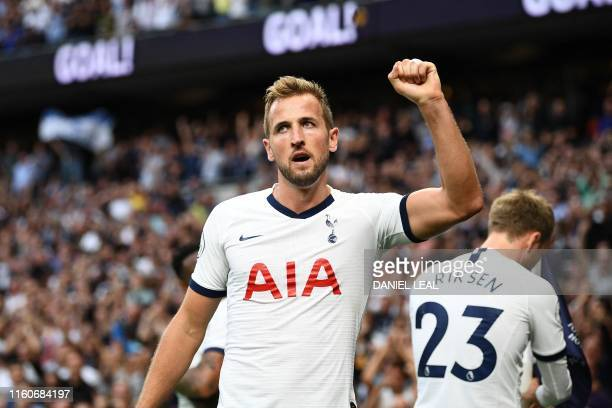 Tottenham Hotspur's English striker Harry Kane celebrates after he scores the team's second goal during the English Premier League football match...