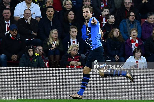 Tottenham Hotspur's English striker Harry Kane celebrates after scoring Tottenham's first goal during the English Premier League football match...