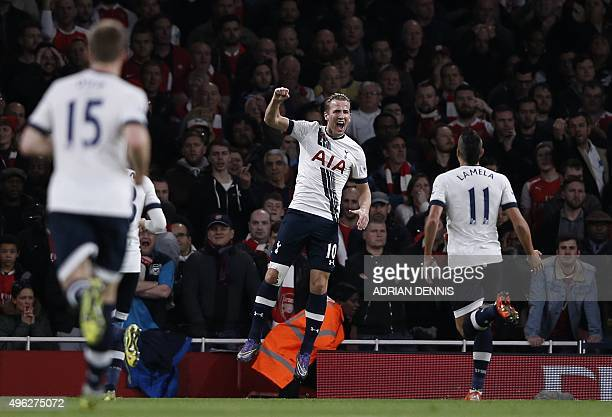 Tottenham Hotspur's English striker Harry Kane celebrates after scoring during the English Premier League football match between Arsenal and...