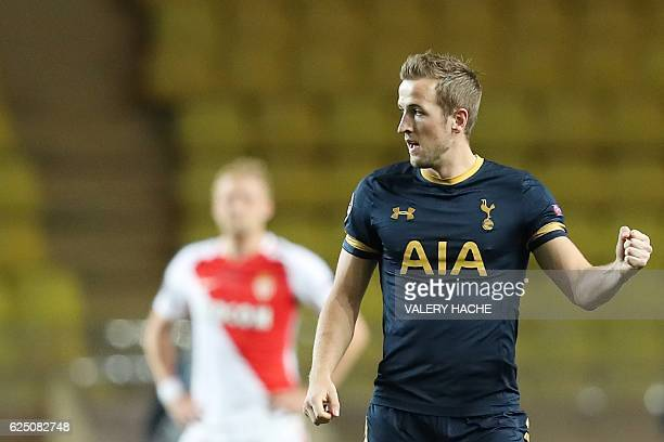 Tottenham Hotspur's English striker Harry Kane celebrates after scoring during the UEFA Champions League group E football match AS Monaco and...