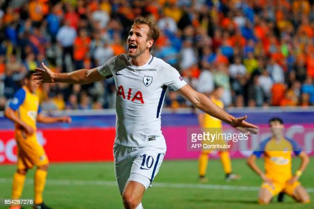 Tottenham Hotspur's English striker Harry Kane celebrates after scoring during the UEFA Champions League football match between Apoel FC and...
