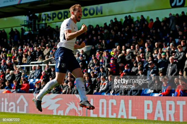 Tottenham Hotspur's English striker Harry Kane celebrates after scoring the opening goal during the English Premier League football match between...