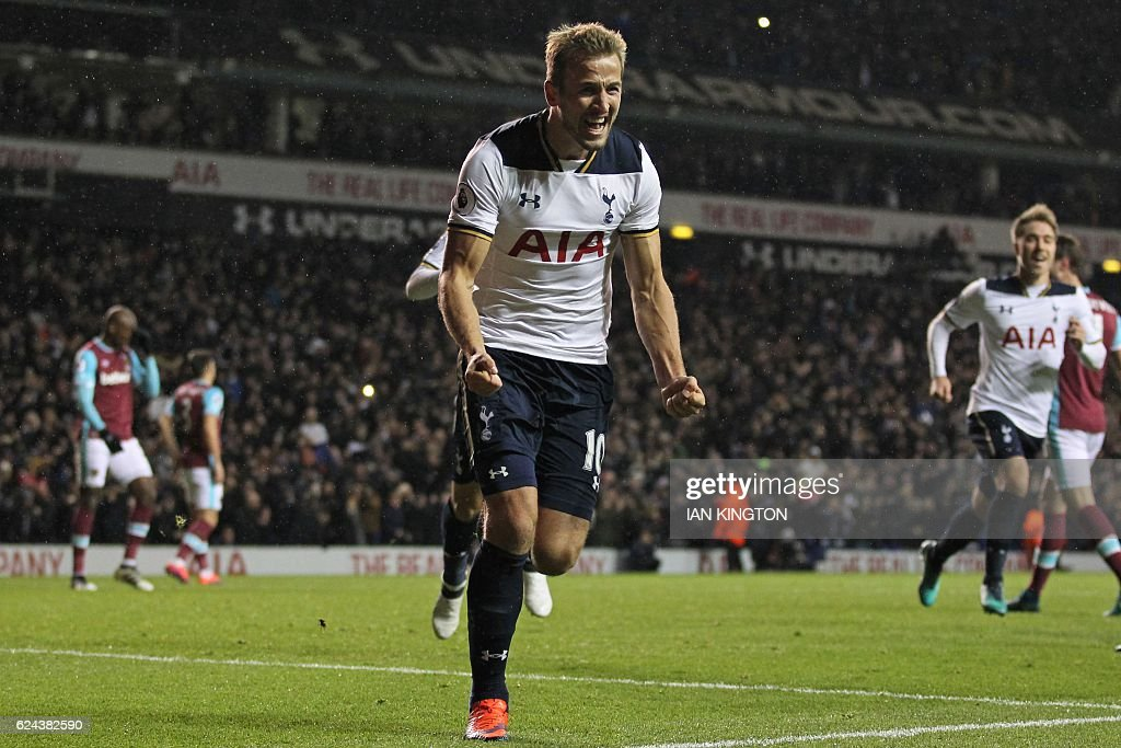 Tottenham Hotspur's English striker Harry Kane celebrates after scoring their third goal from the penalty spot during the English Premier League football match between Tottenham Hotspur and West Ham United at White Hart Lane in London, on November 19, 2016. Tottenham won the game 3-2. / AFP / Ian KINGTON / RESTRICTED TO EDITORIAL USE. No use with unauthorized audio, video, data, fixture lists, club/league logos or 'live' services. Online in-match use limited to 75 images, no video emulation. No use in betting, games or single club/league/player publications. /