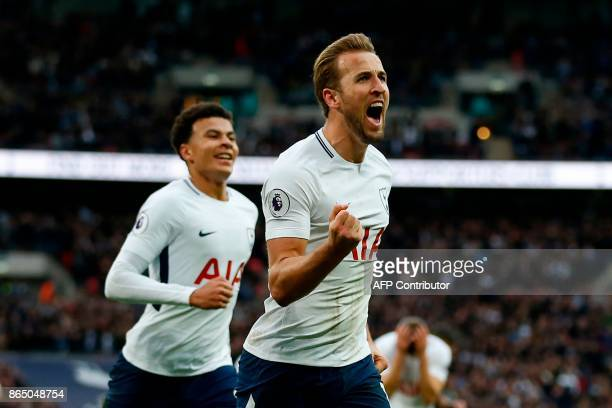 Tottenham Hotspur's English striker Harry Kane celebrates after scoring their fourth goal during the English Premier League football match between...