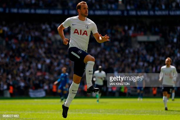 Tottenham Hotspur's English striker Harry Kane celebrates after scoring their first goal during the English Premier League football match between...