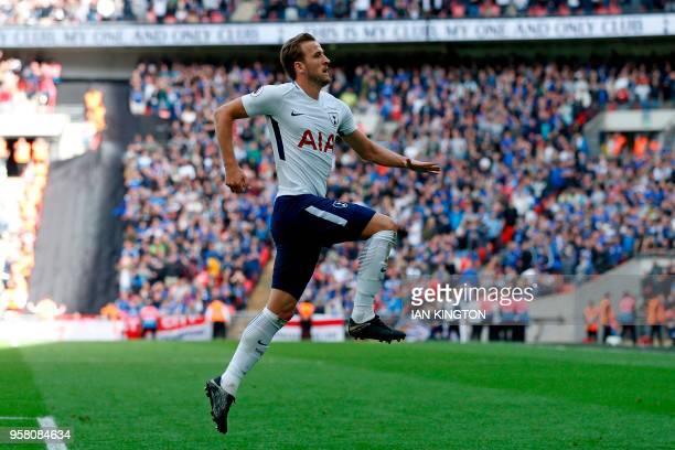 Tottenham Hotspur's English striker Harry Kane celebrates after scoring their fifth goal during the English Premier League football match between...
