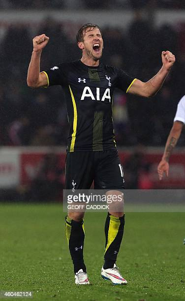 Tottenham Hotspur's English striker Harry Kane celebrates at the final whistle of the English Premier League football match between Swansea City and...