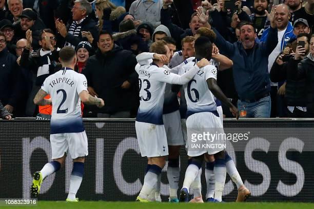 Tottenham Hotspur's English striker Harry Kane celebrates scoring his team's second goal during the UEFA Champions League group B football match...