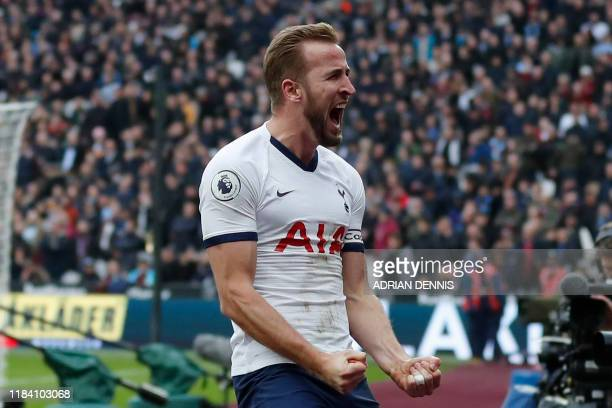 Tottenham Hotspur's English striker Harry Kane celebrates scoring his team's third goal during the English Premier League football match between West...