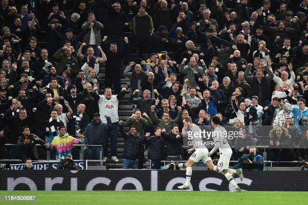 Tottenham Hotspur's English striker Harry Kane celebrates scoring his team's second goal during the UEFA Champions League Group B football match...