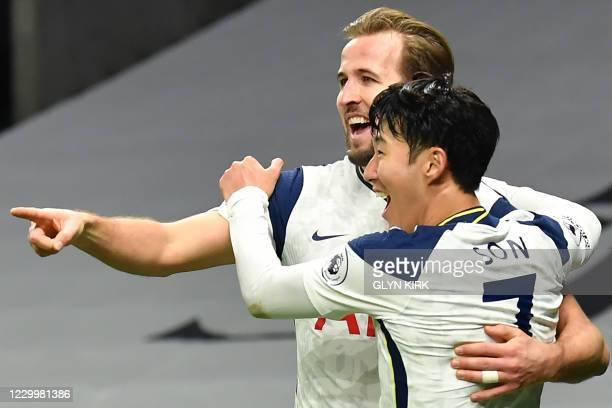 Tottenham Hotspur's English striker Harry Kane celebrates scoring his team's second goal with Tottenham Hotspur's South Korean striker Son Heung-Min...