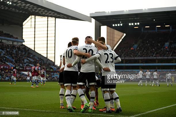 Tottenham Hotspur's English striker Harry Kane celebrates scoring his team's second goal with Tottenham Hotspur's English midfielder Dele Alli during...