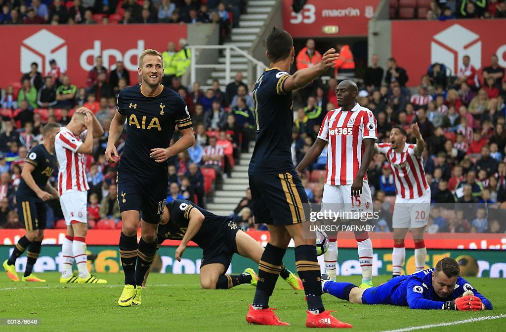 Tottenham Hotspur's English striker Harry Kane celebrates scoring his team's fourth goal during the English Premier League football match between Stoke City and Tottenham Hotspur at the Bet365 Stadium in Stoke-on-Trent, central England on September 10, 2016. / AFP / Lindsey PARNABY / RESTRICTED TO EDITORIAL USE. No use with unauthorized audio, video, data, fixture lists, club/league logos or 'live' services. Online in-match use limited to 75 images, no video emulation. No use in betting, games or single club/league/player publications. /