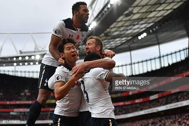 Tottenham Hotspur's English striker Harry Kane celebrates scoring his team's first goal from the penalty spot with Tottenham Hotspur's Belgian...