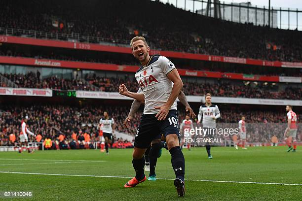 Tottenham Hotspur's English striker Harry Kane celebrates scoring his team's first goal from the penalty spot during the English Premier League...