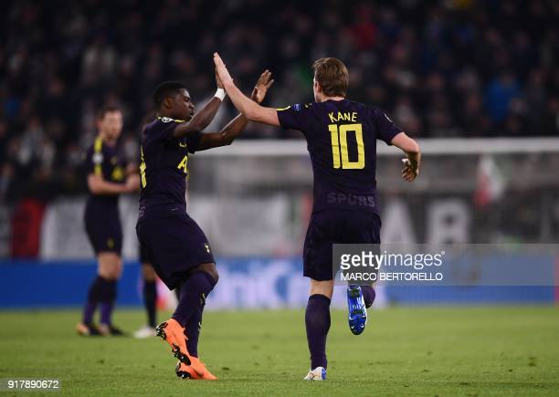 Tottenham Hotspur's English striker Harry Kane celebrates scoring his team's first goal with teammate Ivorian defender Serge Aurier during the UEFA...
