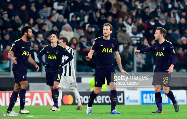 Tottenham Hotspur's English striker Harry Kane celebrates scoring his team's first goal during the UEFA Champions League round of sixteen first leg...