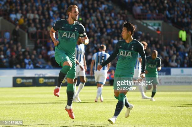 Tottenham Hotspur's English striker Harry Kane celebrates scoring their second goal from the penalty spot with Tottenham Hotspur's South Korean...