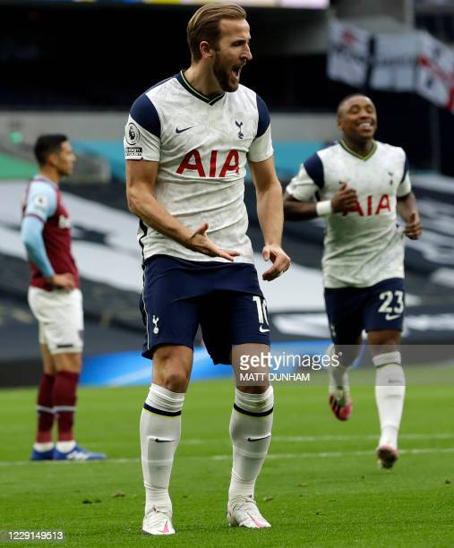Tottenham Hotspur's English striker Harry Kane celebrates scoring the second goal during the English Premier League football match between Tottenham...