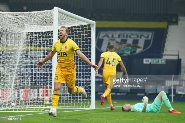 Tottenham Hotspur's English striker Harry Kane celebrates scoring the opening goal during the English Premier League football match between West...