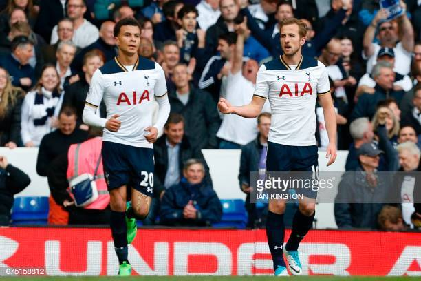 Tottenham Hotspur's English striker Harry Kane celebrates scoring the team's second goal with Tottenham Hotspur's English midfielder Dele Alli during...