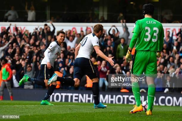 Tottenham Hotspur's English striker Harry Kane celebrates scoring the team's second goal during the English Premier League football match between...
