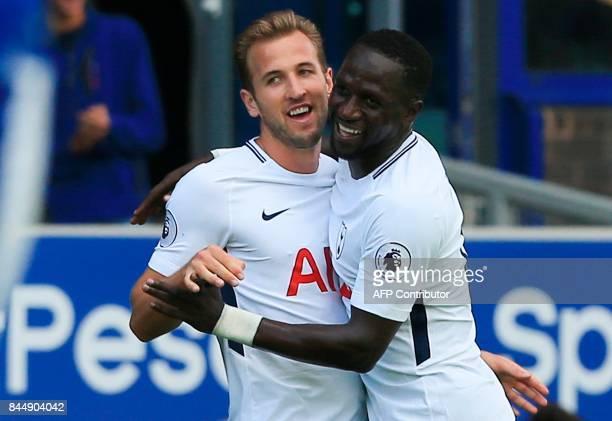 Tottenham Hotspur's English striker Harry Kane celebrates scoring the opening goal with teammate Tottenham Hotspur's French midfielder Moussa Sissoko...