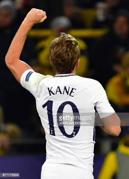 Tottenham Hotspur's English striker Harry Kane celebrates scoring during the UEFA Champions League Group H football match BVB Borussia Dortmund v...