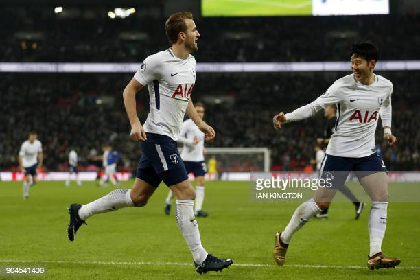 Tottenham Hotspur's English striker Harry Kane celebrates scoring the team's first goal with Tottenham Hotspur's South Korean striker Son HeungMin...