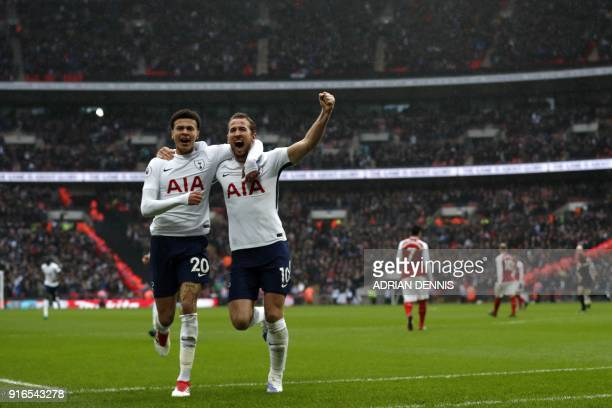 Tottenham Hotspur's English striker Harry Kane celebrates scoring the opening goal with Tottenham Hotspur's English midfielder Dele Alli during the...