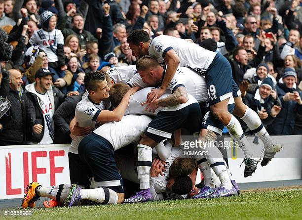 Tottenham Hotspur's English striker Harry Kane celebrates with teammates after scoring their second goal during the English Premier League football...
