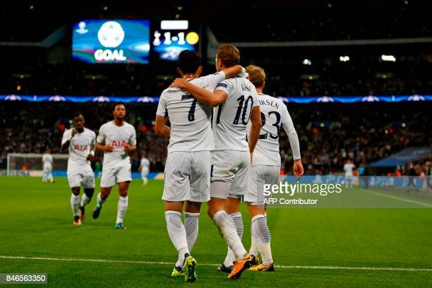 Tottenham Hotspur's English striker Harry Kane celebrates with teammates after scoring their second goal during the UEFA Champions League Group H...