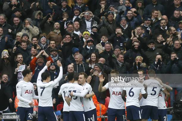 Tottenham Hotspur's English striker Harry Kane celebrates with taemmates after scoring the opening goal during the English Premier League football...