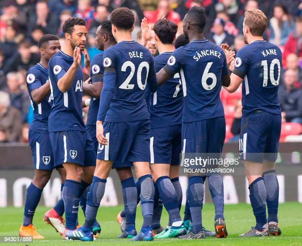 Tottenham Hotspur's English striker Harry Kane celebrates with teammates after Tottenham Hotspur's Danish midfielder Christian Eriksen crossed the...