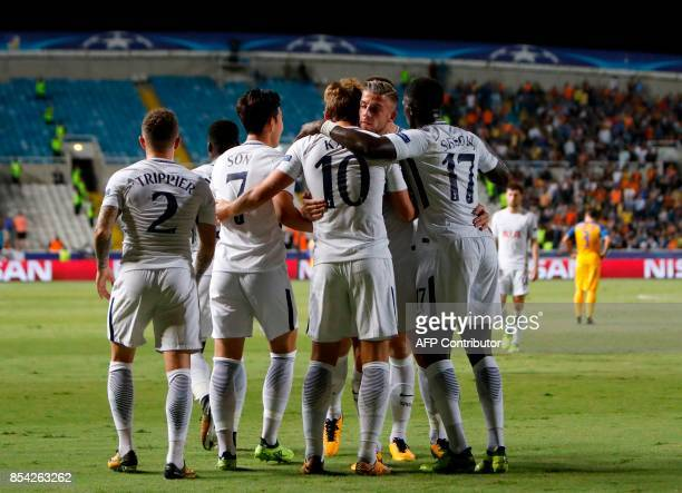 Tottenham Hotspur's English striker Harry Kane celebrates with his teammates after scoring during the UEFA Champions League football match between...