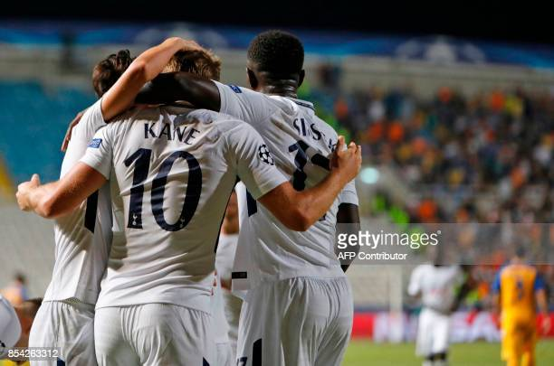 Tottenham Hotspur's English striker Harry Kane celebrates with his teammates Son Heungmin and Moussa Sissoko after scoring during the UEFA Champions...