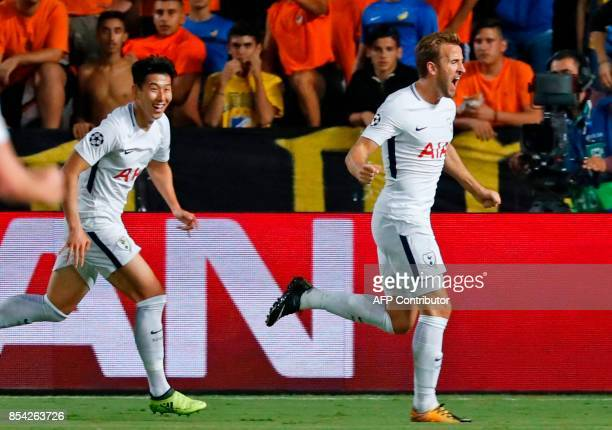 Tottenham Hotspur's English striker Harry Kane celebrates with his teammate Son Heungmin after scoring during the UEFA Champions League football...